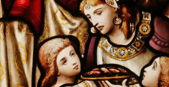 Stained Glass Image of woman serving bread